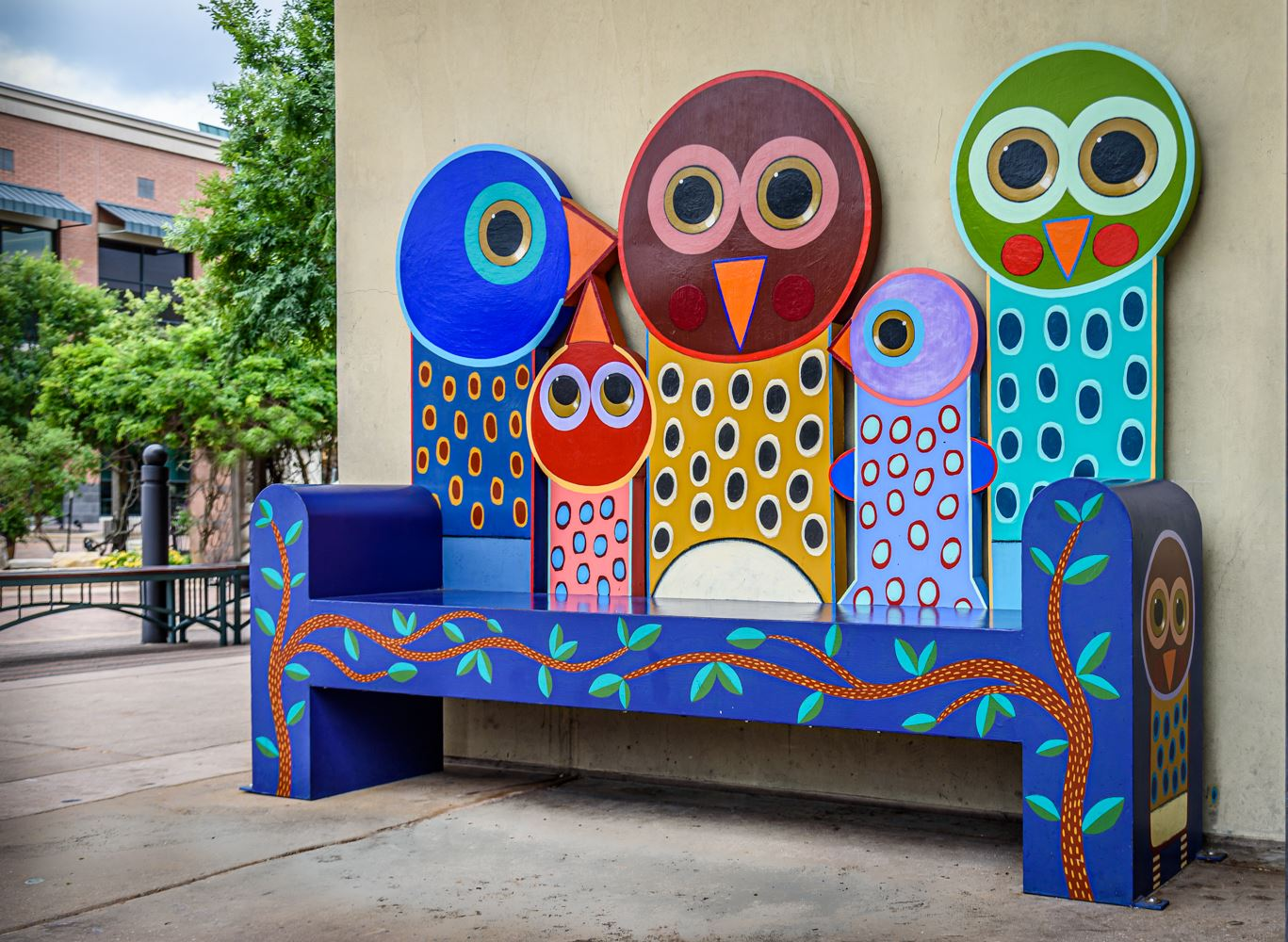 Colorful bench with birds as the backing