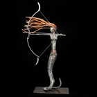 woman drawing a bow sculpture