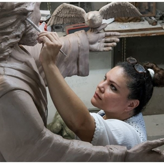 Woman working on a sculpture