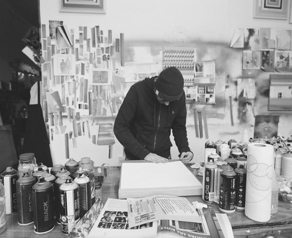 Man in black hoodie making art