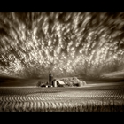 Alternative process photographic prints that feature dramatic weather scenes that also tell a story