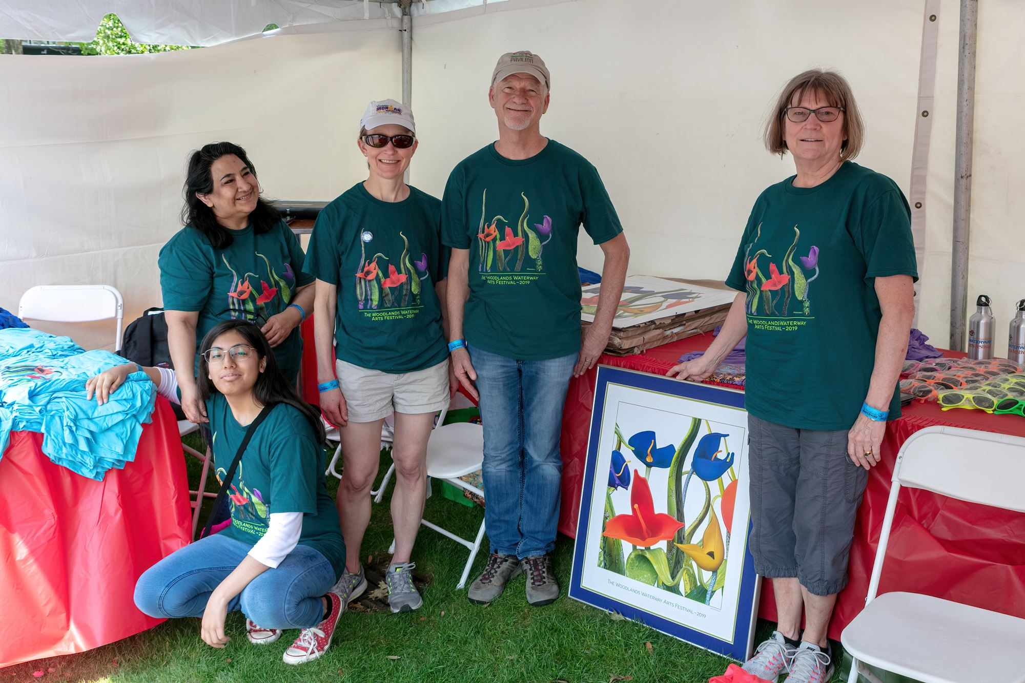 Group photo of volunteers standing in volunteer tent