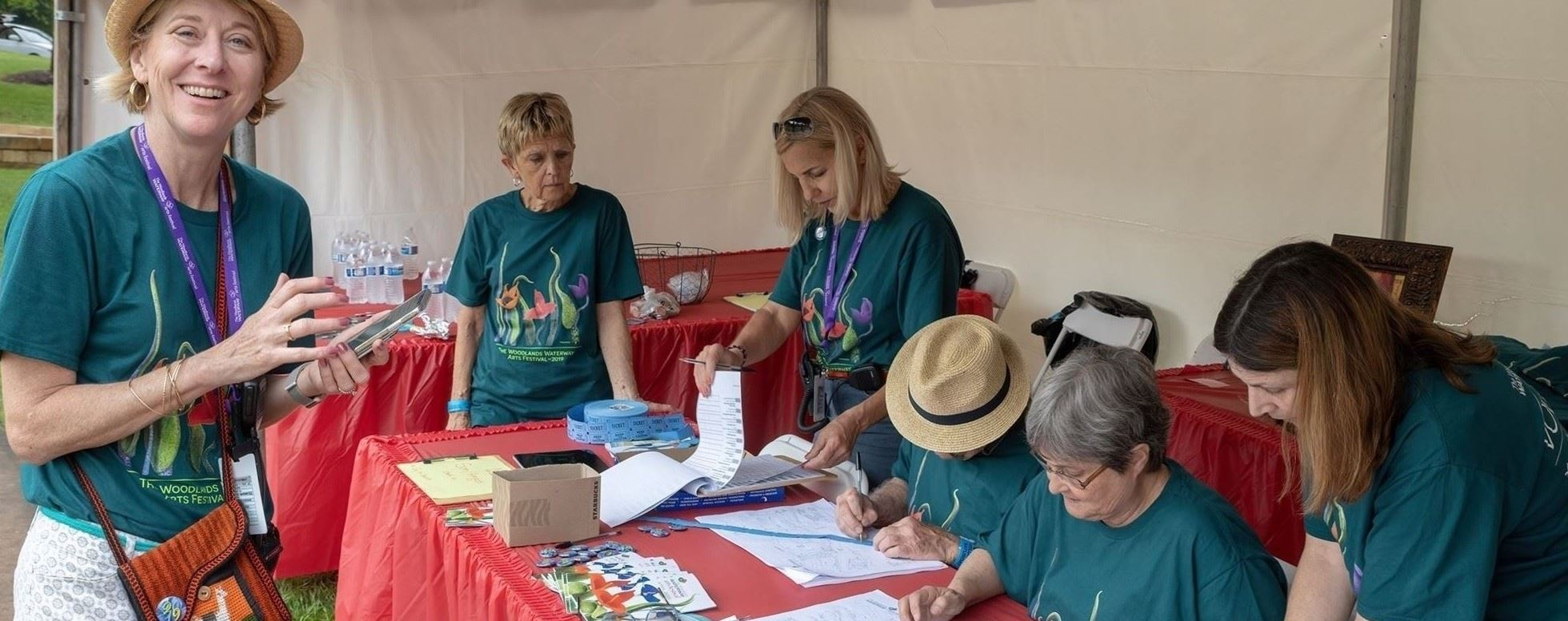 Group of women working at the volunteer tent