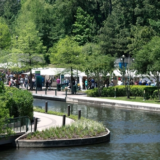 waterway and trees with artist tents