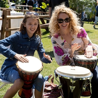 Woman and girl playing the drums