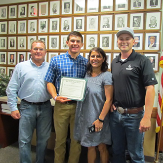 Sammy Gonzales with parents and YF&R Chair Justin Rominger